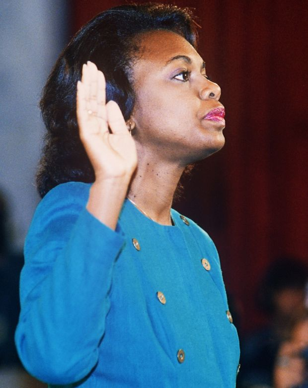 Oct. 12, 1991: Law professor Anita Hill takes the oath before the Senate judiciary committee to testify about alleged sexual harassment by then Supreme Court nominee Clarence Thomas. JENNIFER LAW