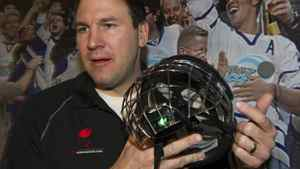 Former NHL player Keith Primeau shows the Battle Sports Science Impact Indicator installed in a helmet during a concussion news conference in Toronto on Monday November 14, 2011.Primeau and stopconcussions.com were announcing new initiatives in the battle to reduce and better treat concussions in sport.