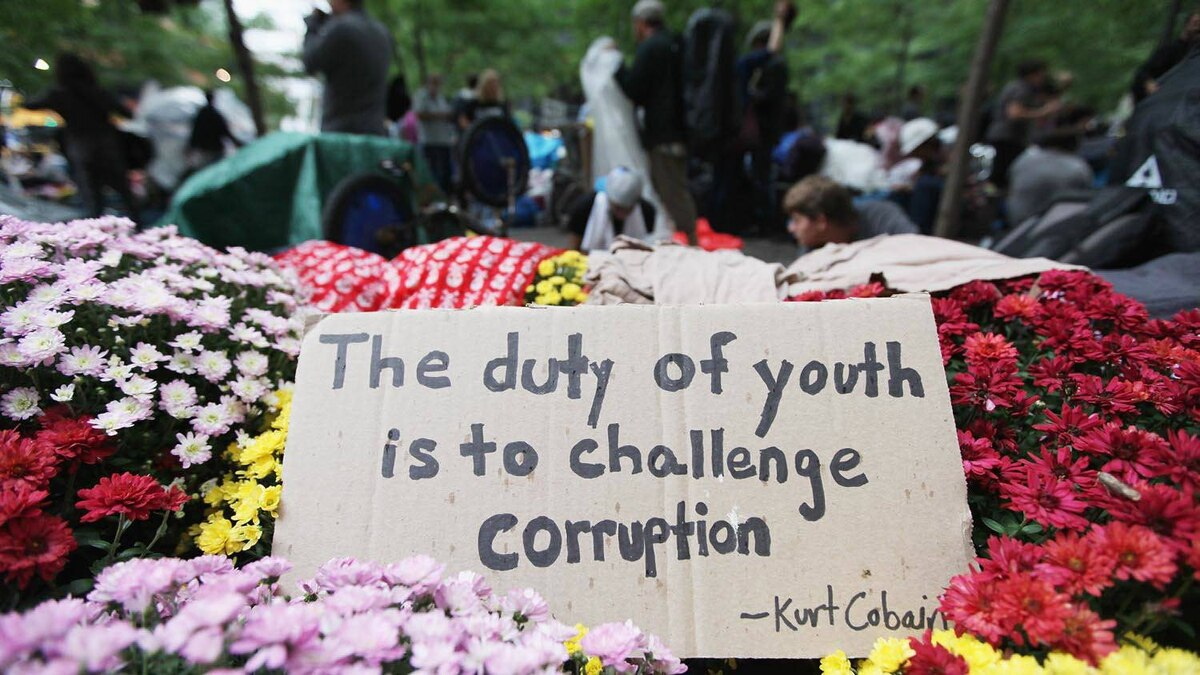 A sign, with a quote from the late musician Kurt Cobain, sits in Zuccotti Park, set down during the Occupy Wall Street protests Oct. 1, 2011.