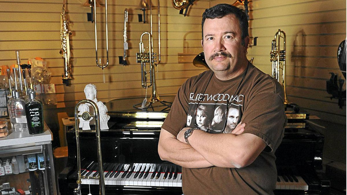 Michael Durocher, shown at Campbell's Music Store on May 9, 2012, was laid off from Keyano College in Fort McMurray where he taught musical instrument repair.