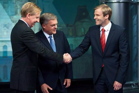 New Brunswick Liberals link Alward to Harper as voters head to polls