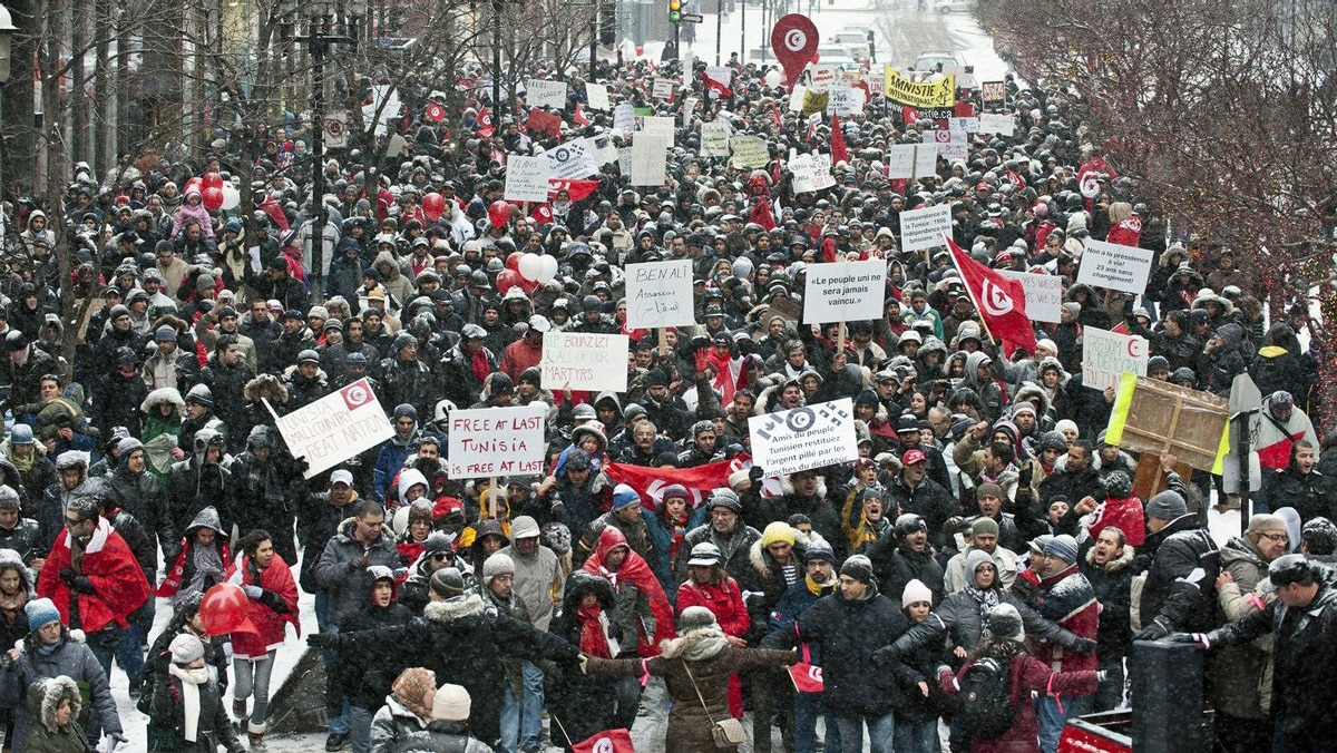 Thousands of Tunisians from Montreal, came to rally in the downtown streets of Montreal, Quebec, Canada, January 15, 2011.