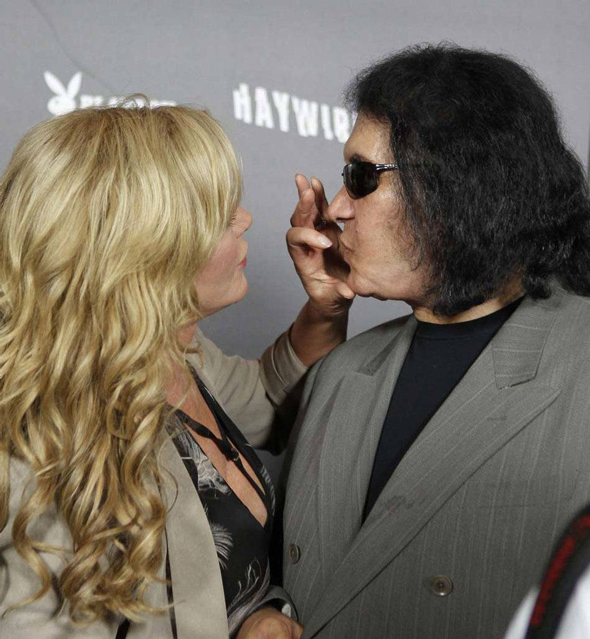 """Shannon Tweed (left) demonstrates the only known way of getting her handsome husband Gene Simmons to shut up at the premiere of """"Haywire"""" in Los Angeles last week."""
