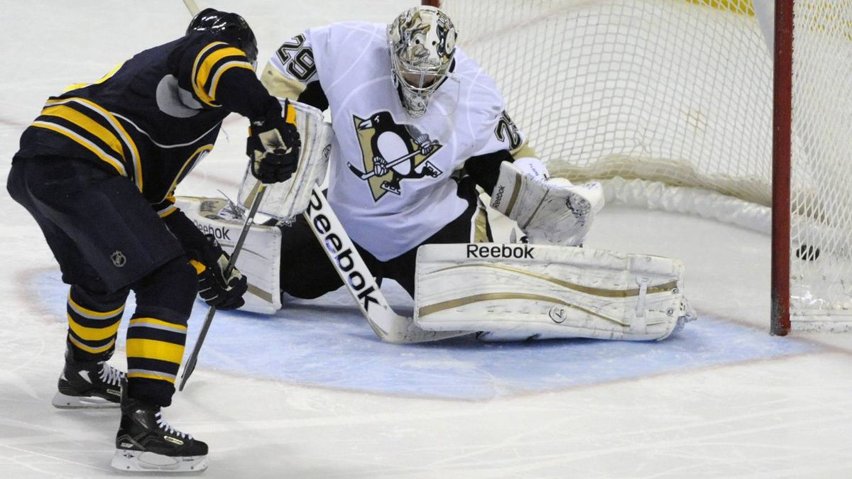Buffalo Sabres' Derek Roy (9) scores on Pittsburgh Penguins' Marc-Andre Fleury (29) during the third period of an NHL hockey game in Buffalo, N.Y., Sunday, Feb. 19, 2012. Buffalo won, 6-2. (AP Photo/Gary Wiepert)