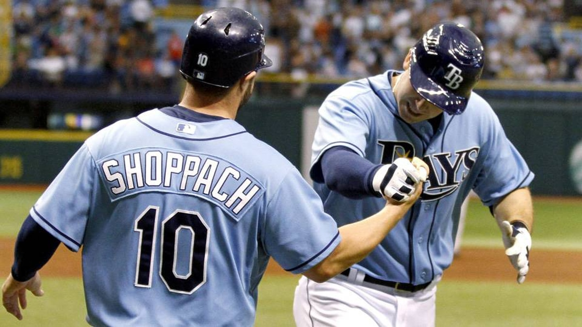 Tampa Bay Rays' Kelly Shoppach (10) congratulates Rays' Evan Longoria on a two-run homer against the Toronto Blue Jays during the second inning of a baseball game, Sunday.