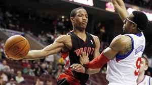 Toronto Raptors shooting guard DeMar DeRozan (10) passes the ball around Philadelphia 76ers forward Andre Iguodala (9) in the first half of an NBA basketball game, Wednesday, April 4, 2012, in Philadelphia.