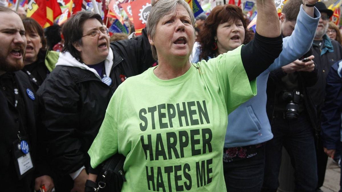 Hundreds of people march through downtown Ottawa to protest against federal budget cuts on May 1, 2012.