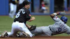 Toronto Blue Jays' shortstop John McDonald (L) tags out Texas Rangers' base runner Endy Chavez trying to steal second base during the first inning of their MLB American League baseball game in Toronto July 31, 2011. REUTERS/Mike Cassese