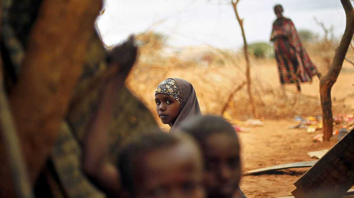 Somali refugees sit an an outdoor camp near Dadaab, Kenya on Aug. 9, 2011.