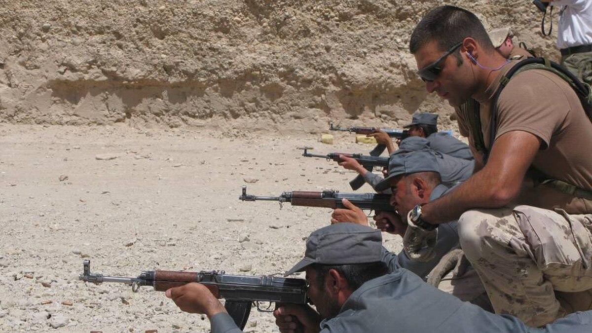 Cpl. Steven Kuzevski, a Canadian Forces MP, trains Afghan National Police officers on the firing range.