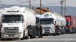 Truckers wait to fill up their trucks as oil refinery workers block their plant in Berre l'Etang, southern France, Wednesday Oct.13, 2010.