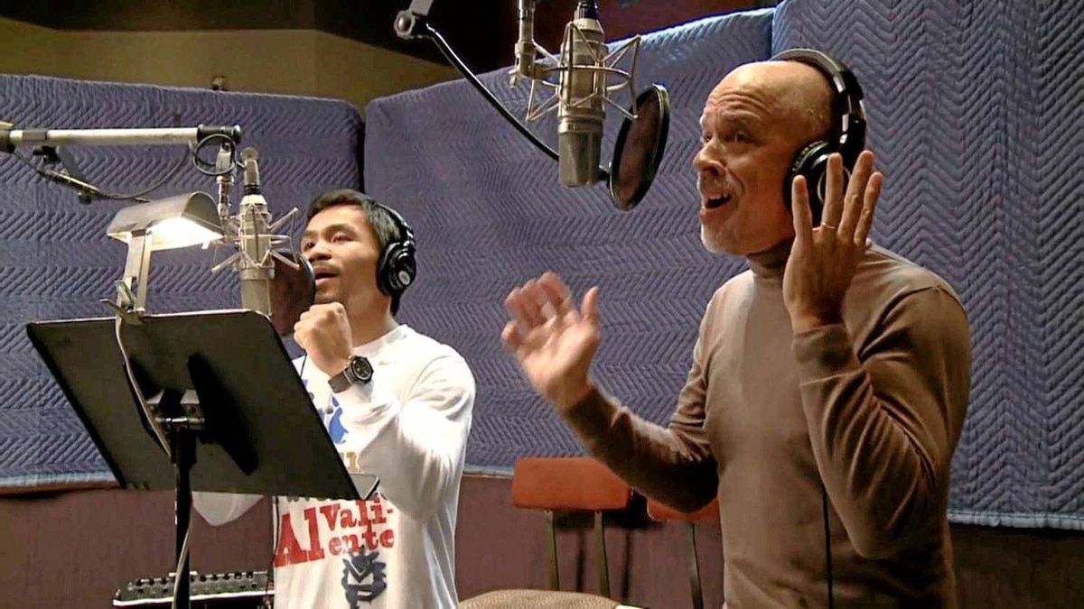 """Dan Hill (right) records a version of his hit """"Sometimes When We Touch"""" with boxer Manny Pacquaio."""