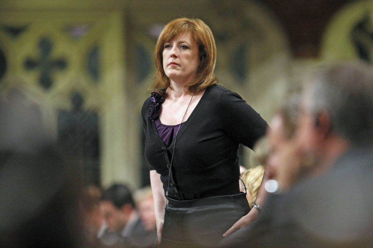 Natural Resources Minister Lisa Raitt stands to address her critics during Question Period on June 9, 2009.