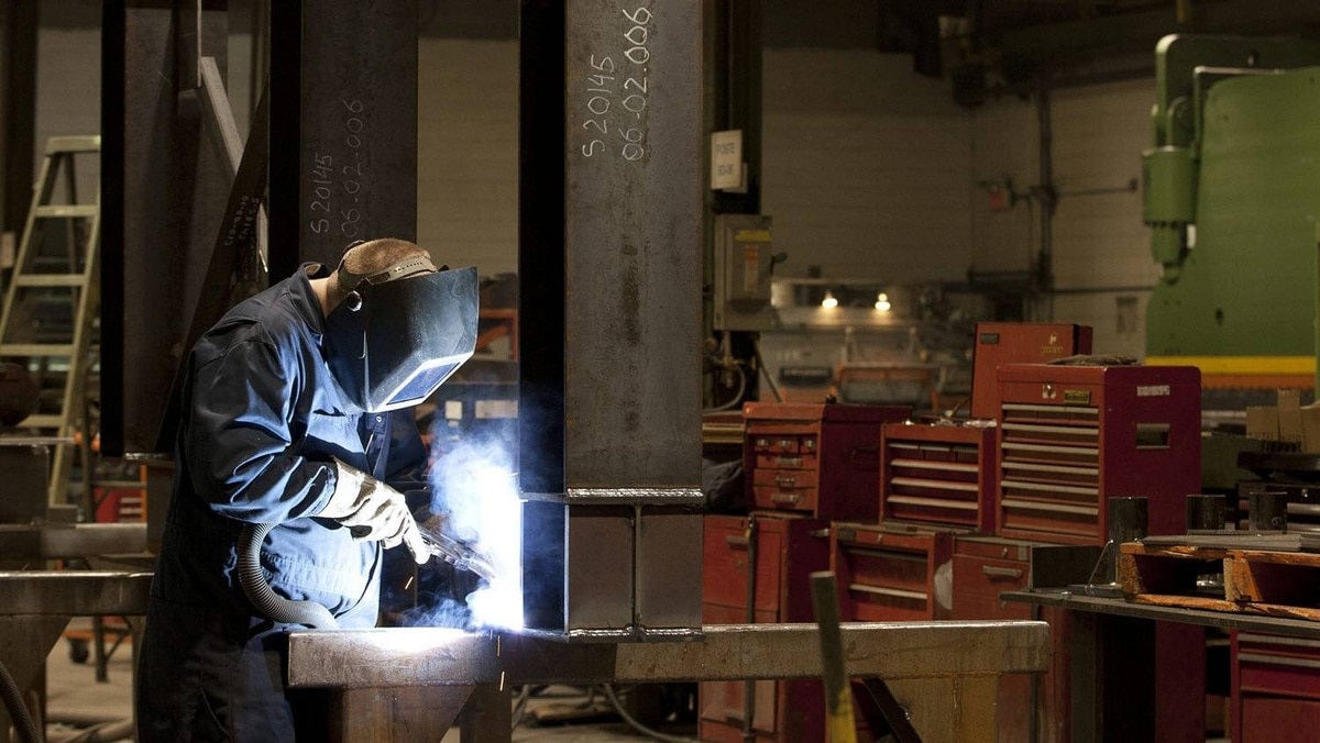 A welder works in a factory in Quebec City where Quebec Premier Jean Charest announced financial support under the Plan Nord to allow a company to train northern Quebec workers, Feb. 28, 2012.