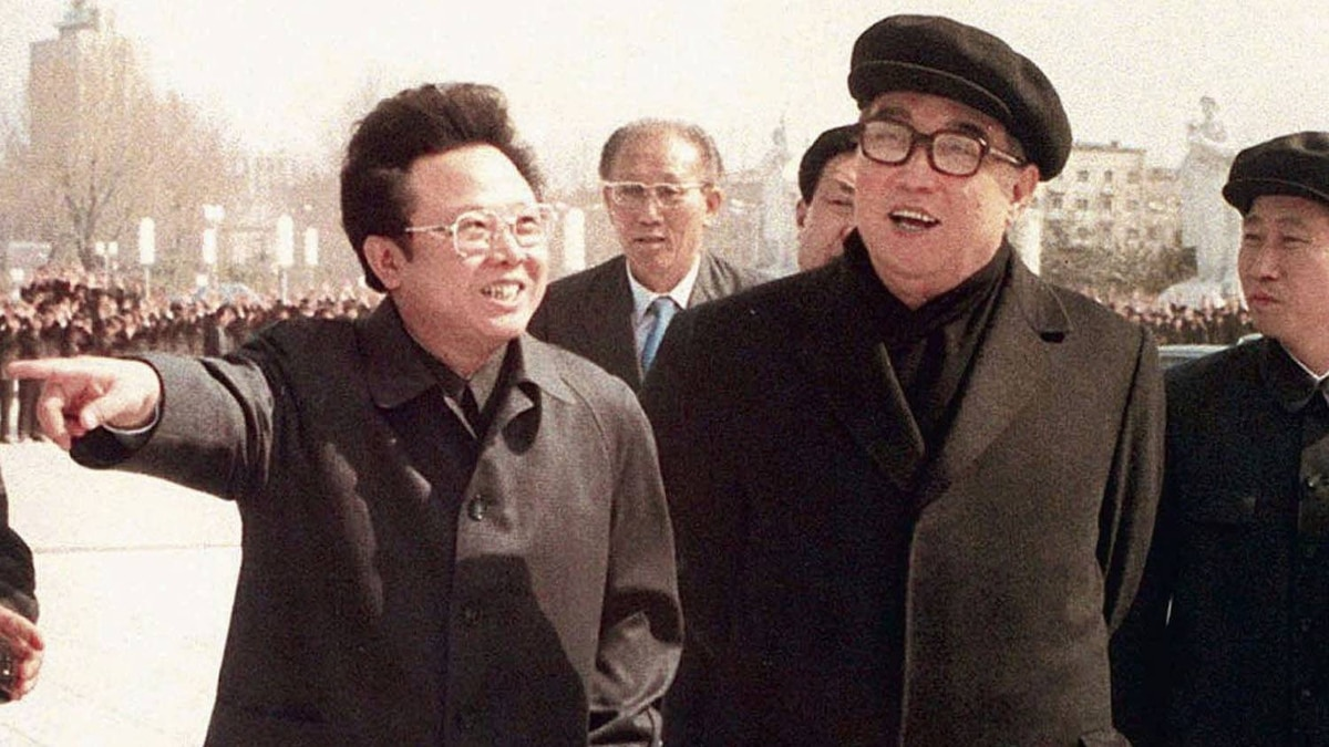 Kim Jong-il strolls with his father North Korean leader Kim Il Sung, right, in Pyongyang in this April 1982 file photo.