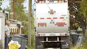 Vancouver resident George Bayley watches the garbage truck as it makes its way through the alleyway behind Mr. Bayley's home in East Vancouver October 15, 2007.