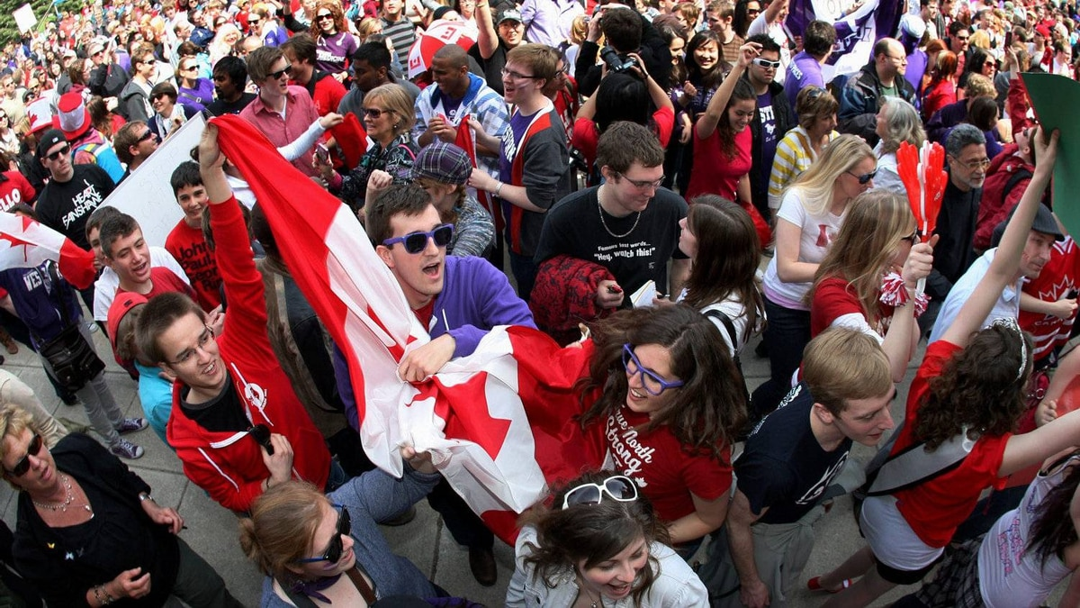 People dance at a pre-election gathering in London, Ont., Saturday, April 30, 2011.