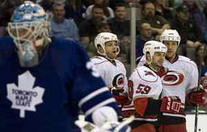 Carolina Hurricanes Chad LaRose (centre right) celebrates scoring the Hurricanes' opening goal with teammates Tim Gleason (centre left) and Andrew Alberts (right) as they skate past Toronto Maple Leafs goaltender Jean-Sebastien Giguere during first period action of the NHL game in Toronto on Tuesday March 2, 2010.