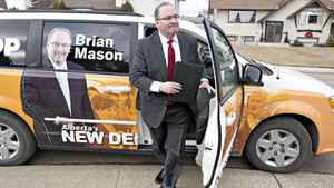 NDP Leader Brian Mason makes his way to a residential home to make his platform announcement in Edmonton March 28, 2012, for the upcoming Alberta provincial election. Voters in Alberta will go to the polls on Monday, April 23, 2012.