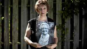 Joyce Western poses with a portrait of her late mother, Marjorie Howse, in St. Catherines, Ont. Sunday, July 3, 2011. Ms. Howse died after a C. difficile infection.