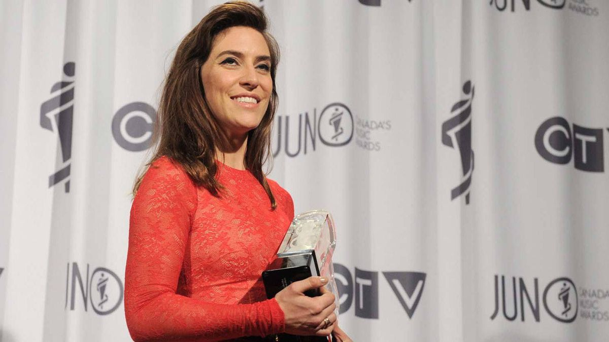 Feist poses with the Juno award for the Artist of the Year during the Juno Awards ceremony in Ottawa, Sunday April 1, 2012.