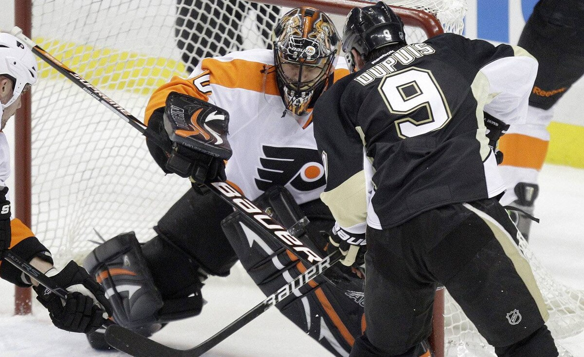Pittsburgh Penguins' Pascal Dupuis (9) wrists his first-period goal past Philadelphia Flyers goalie IIya Bryzgalov during Game 1 of an opening-round NHL hockey playoff series Wednesday, April 11, 2012, in Pittsburgh.
