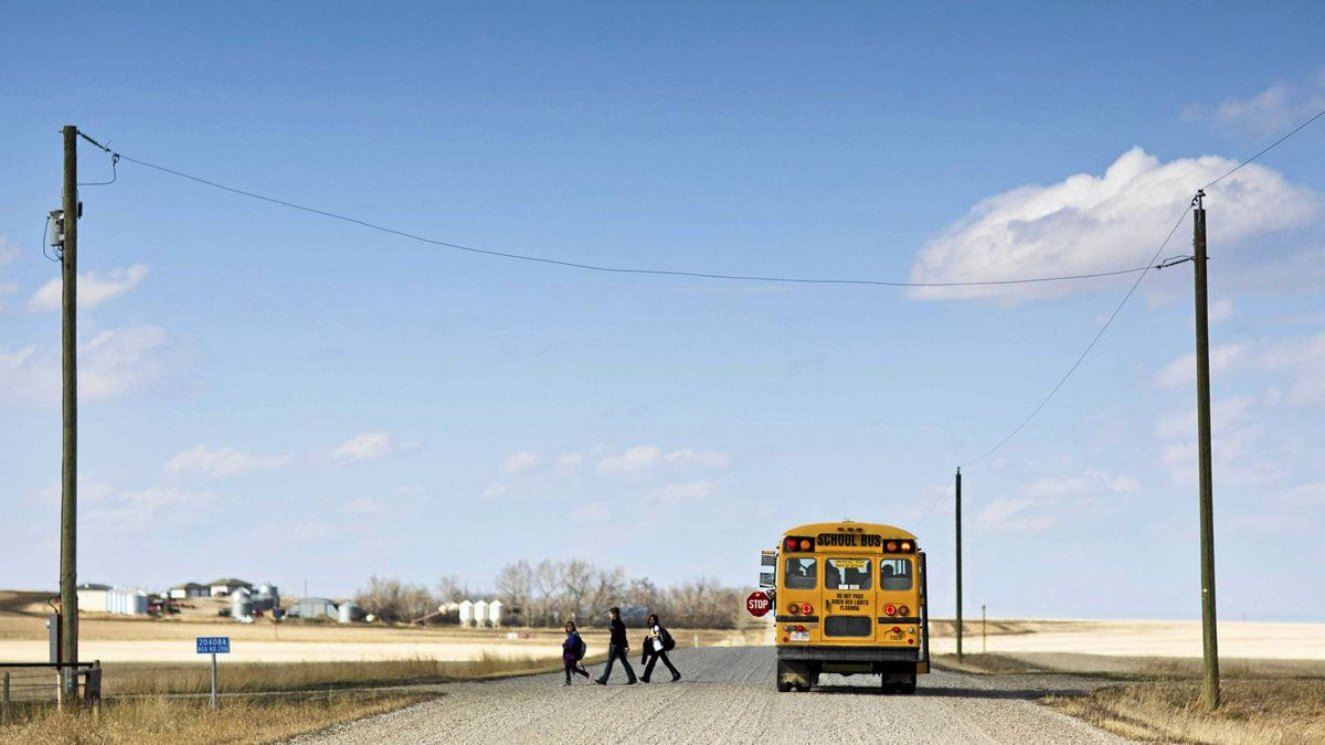 Children are dropped off by a school bus in the rural town of Mossleigh, AB on April 19, 2012. The town is in the provincial riding of Little Bow, where John Kolk, PC party and Ian Donovan, Wildrose party are running.