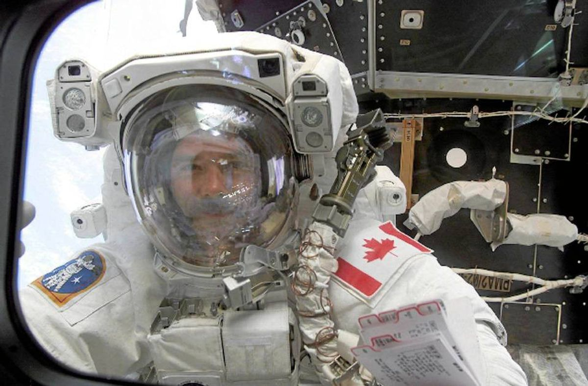 US space shuttle Endeavour astronaut Canadian Chris Hadfield peers in a shuttle window, 22 April 2001, after successfully setting up the Canada Arm 2 on the Destiny module of the International Space Station during first spacewalk.