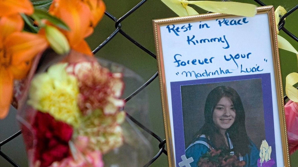 A photo of Kimberly Proctor, an 18-year-old from Langford whose burned body was found Friday at Millstream Creek beneath the Galloping Goose Trail along the Langford-Colwood border, sits at a memorial Tuesday near the location she was discovered.