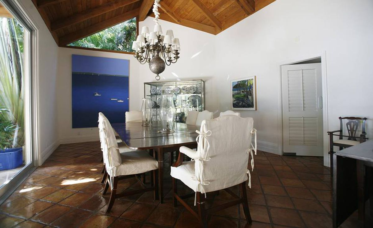 The formal dining room at Bernard Madoff's Palm Beach, Fla. home sits empty Tuesday, Sept. 8, 2009. The house was seized by the government and will be sold at auction.