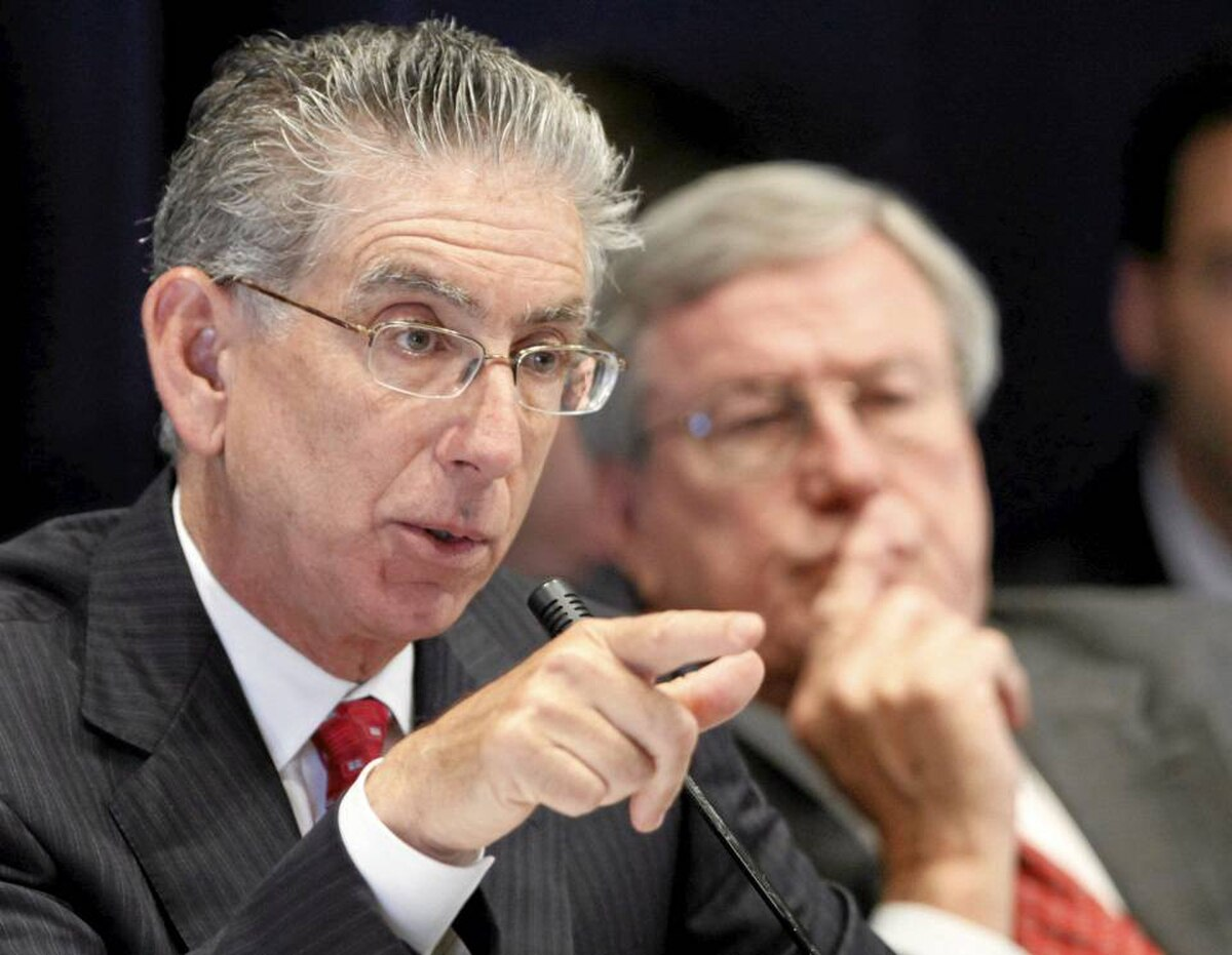 Philip Angelides, left, chairman of the Financial Crisis Inquiry Commission, and vice chairman Bill Thomas, listen to testimony Wednesday in New York.