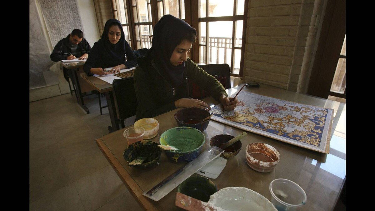 Art students make designs for carpets at a university in Isfahan, 390 km south of the capital Tehran, Iran Monday, Nov. 14, 2011. Deep in Tehran's carpet bazaar, the merchants and laborers occupy chambers that have changed little over the centuries.