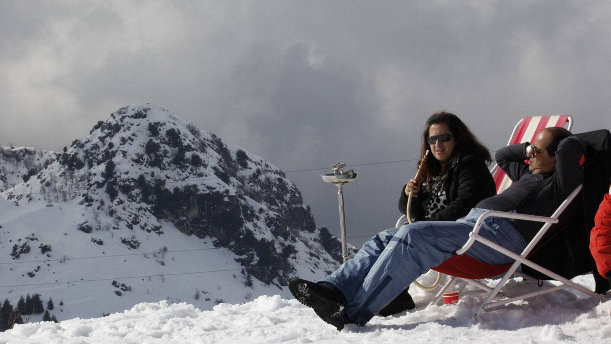 A couple share a shisha at the Laqlouq ski resort about an hour from Beirut.