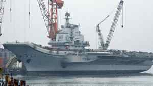 A former Soviet aicraft carrier in drydock in China where it is being modernized. Mineral and and gas resources in the South China Sea are claimed by six countries, including Vietnam and China. REUTERS