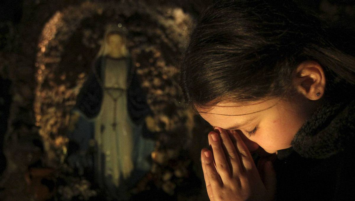 An Iraqi girl attends a Christmas mass at Chaldean Catholic church in Amman early December 25, 2011. Thousands of Iraqi Christians fled to neighbouring Jordan following a spate of bombings that targeted churches in Iraqi cities in the past few years.