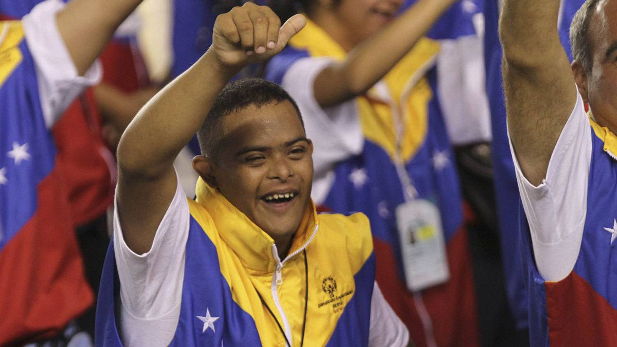 A Venezuelan athlete waves to the public during the opening ceremony of the 2nd Central American and Caribbean Special Olympic Games in Panama City April 15, 2012. The Games will take place in Panama City from April 15 to 20. REUTERS/Carlos Jasso