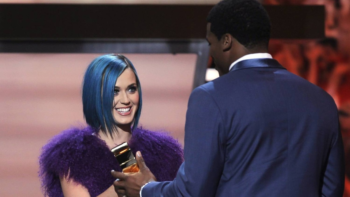 Singer Katy Perry (L), presents the Offensive Rookie of the Year trophy to Cam Newton of the Carolina Panthers at the Inaugural National Football League Honors at Super Bowl XLVI in Indianapolis, Indiana, February 4, 2012. REUTERS/Lucy Nicholson