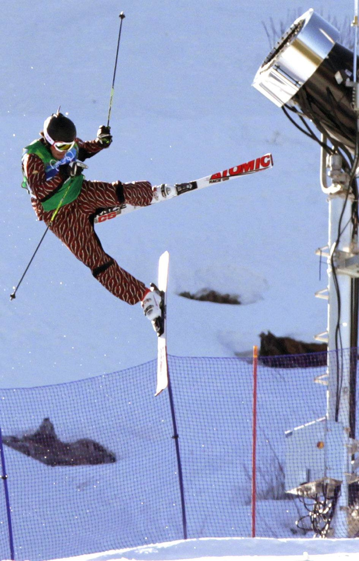 Christopher Del Bosco, of Canada, loses control in the air and crashes and finishes in fourth place during the men's ski cross final at Cypress Mountain in West Vancouver, B.C., on Sunday February 21, 2010.