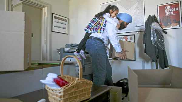 May 11, 2011: Outgoing Liberal MP Navdeep Bains with the help of his daughter Nanki Kaur Bains 3 1/2yr packs up his Parliament Hill office in Ottawa.
