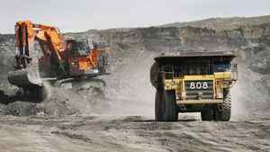 A haul truck carryong a full load drives away from a mining shovel at the Shell Albian Sands oilsands mine near Fort McMurray, Alta., Wednesday, July 9, 2008.