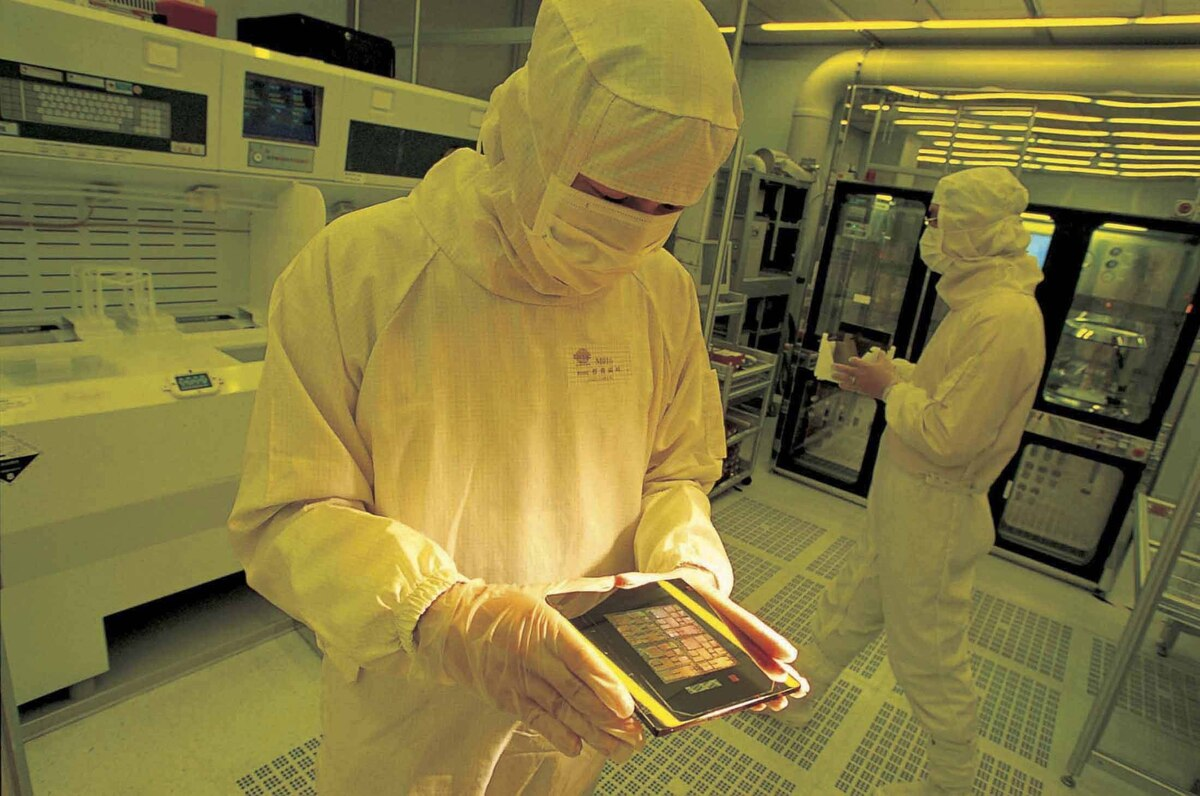 An undated handout shows employees working inside a Taiwan Semiconductor Manufacturing Company (TSMC) 8-Inch Wafer Fab laboratory in Taiwan.