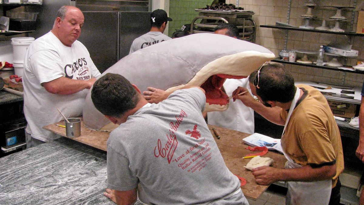 Fine-tuning the fondant on the Shark Cake on Cake Boss.