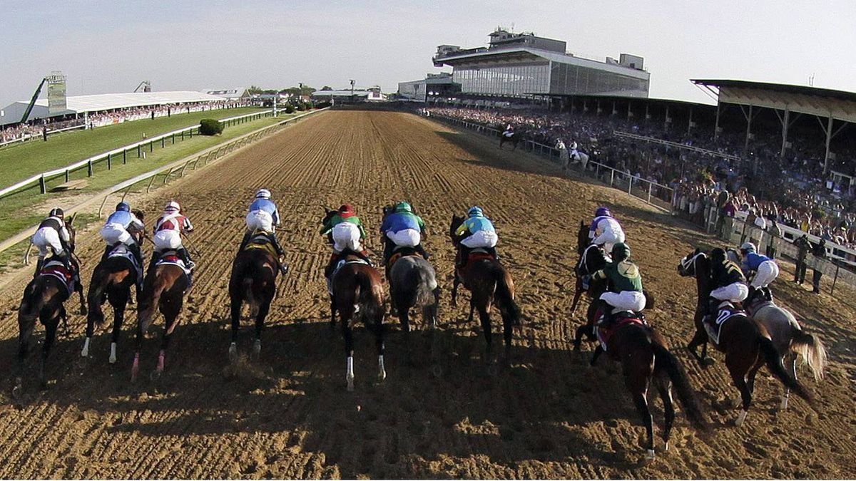 In this image taken with a fisheye lens, the field breaks from the starting gate for the 137th Preakness Stakes horse race at Pimlico Race Course, Saturday, May 19, 2012, in Baltimore. I'll Have Another, third from right, ridden by Mario Gutierrez (purple cap), who started from the ninth position won the race. (AP Photo/Pat Semansky)