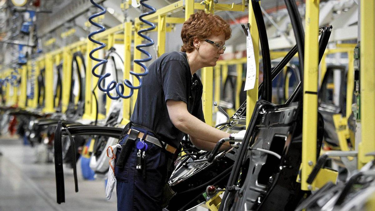 A worker assembles car doors at the main Volvo factory in Gothenburg. Sweden's prime minister is calling for the retirement age to be raised to 75.