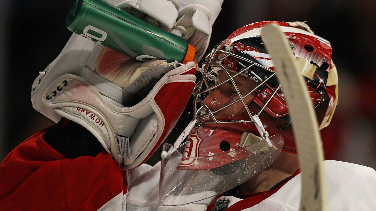 Jimmy Howard #35 of the Detroit Red Wings sprays water onto his face during a break in the action against the Chicago Blackhawks at the United Center on April 10, 2011 in Chicago, Illinois. The Red Wings defeated the Blackhawks 4-3. (Photo by Jonathan Daniel/Getty Images)