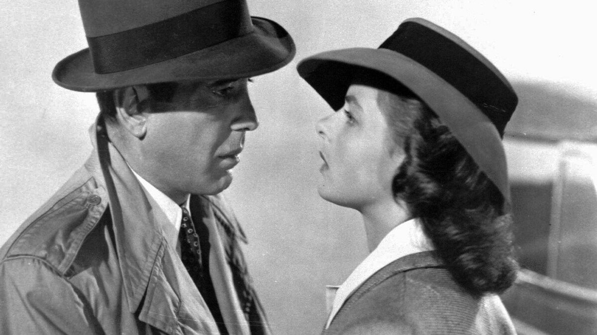 Humphrey Bogart -- in a Burberry trench coat -- and Ingrid Bergman in a scene from the 1943 film Casablanca.