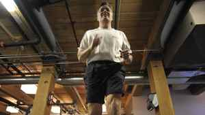 David MacDonald, CEO of Softchoice Corp., runs on the treadmill at his office gym.