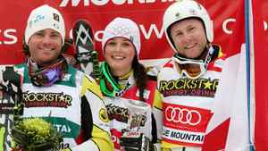 Chris Del Bosco (men's 2nd place), left to right, Marielle Thompson (ladies winner) and Brady Leman (men's winner), all of Canada, celebrate together on the podium at the FIS Ski Cross World Cup race at Blue Mountain in Collingwood, Ontario, Friday, February 3, 2012. THE CANADIAN PRESS/Dave Chidley