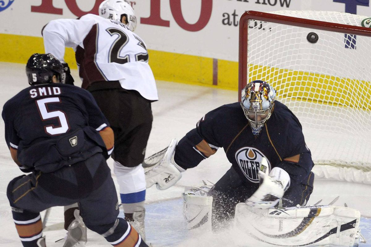 Edmonton Oilers defenceman Tomas Smid, seen chasing down Colorado Avalanche forward Milan Hejduk in front of goaltender Nikolai Khabibulin on Tuesday night, returned to the team after being sidelined with H1N1.