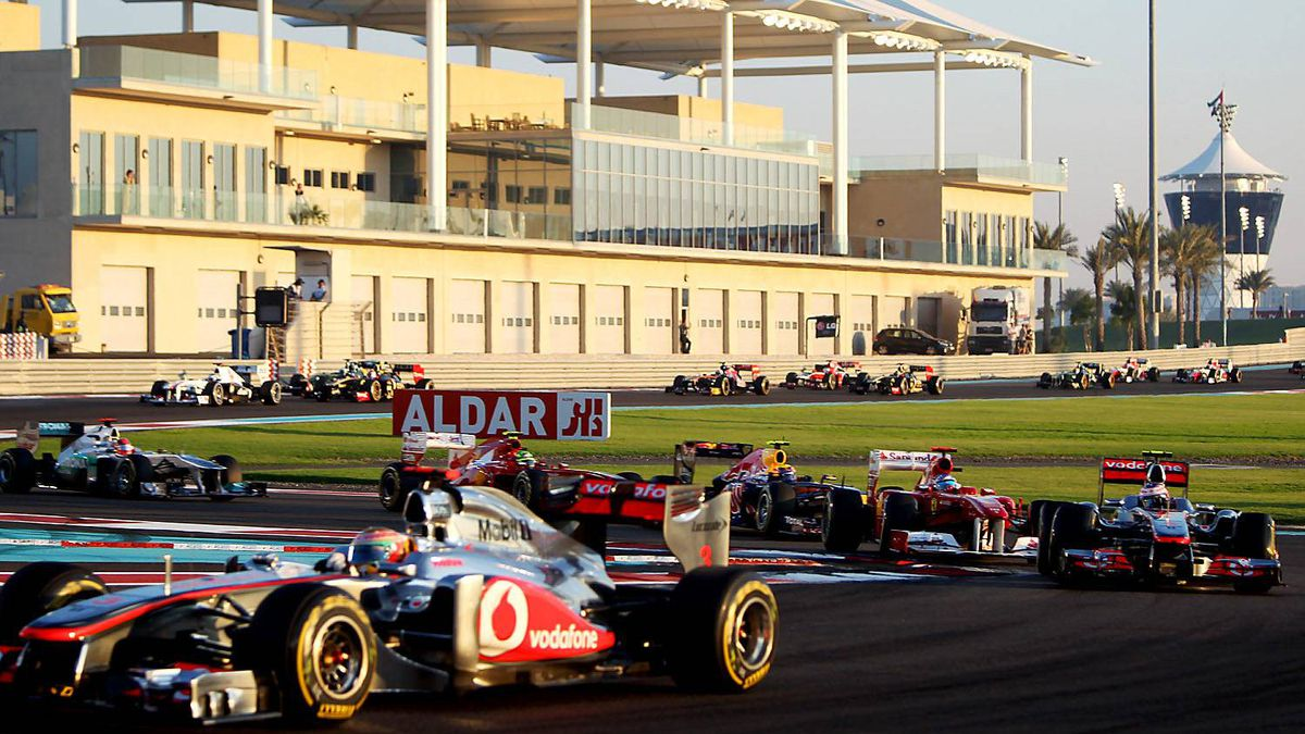 Lewis Hamilton (L) leads at the Yas Marina circuit on November 13, 2011 in Abu Dhabi during the Abu Dhabi Formula One Grand Prix.